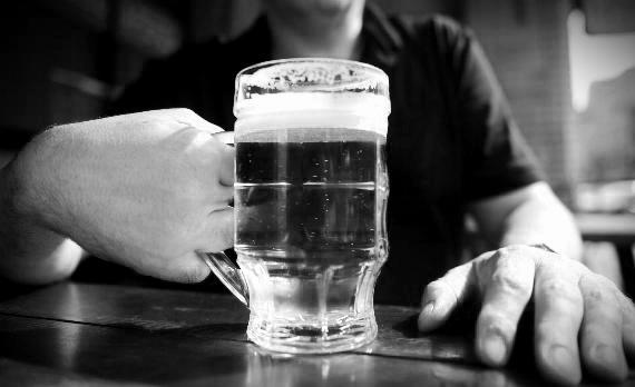 Man Holding Beer Mug