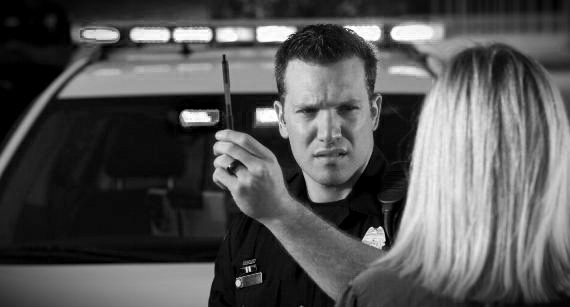 Policeman Conducting Field Sobriety Test