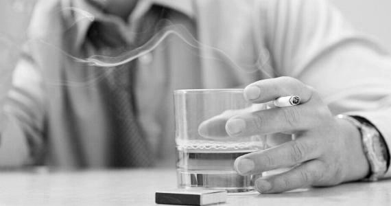 Man With Cigarette Hold Drink Glass