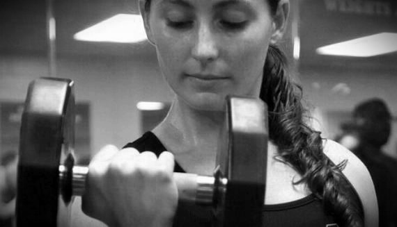Woman in Gym With Barbell